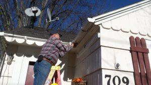 Don Z repairing gutter